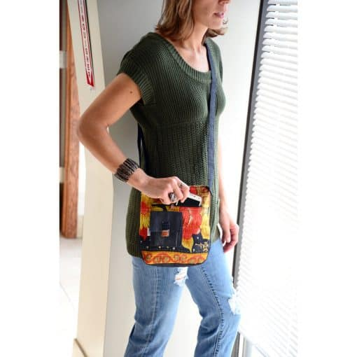 Crossbody purse in upcycled denim and recycled saris.