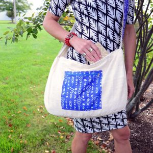 Vegan friendly, large cross-body tote with adjustable strap.