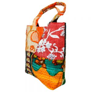 Small purse with recycled sari patches.