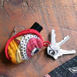 Key ring coin purse, lipstick case, pill pouch in recycled saris.