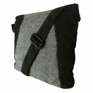 Crossbody laptop bag in upcycled denim.