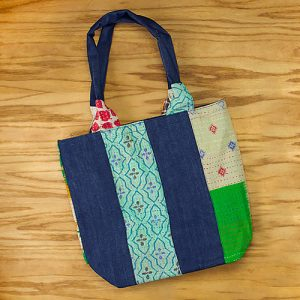 Large tote with zip close in upcycled denim, recycled saris.