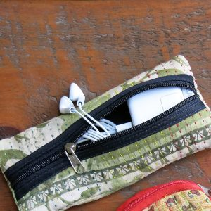 Flat pencil case in recycled saris with waterproof lining, great for cords and more.