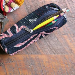 Round pencil case in recycled saris with waterproof lining, great for cords and more.