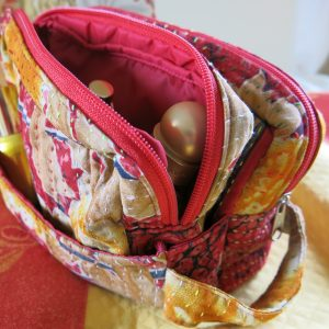 2 in 1 travel toiletry bag with a detachable purse for smaller items.
