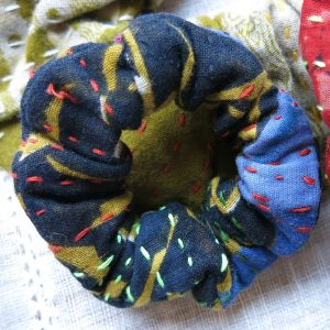 Strong small scrunchies in recycled saris.