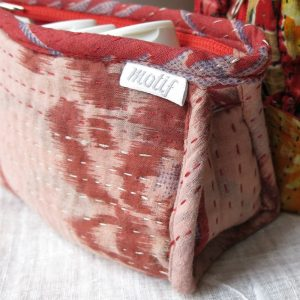 Small toiletry bag made with recycled saris, waterproof lining, pocket.