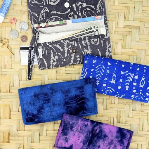 Fabric wristlet, wallet, purse with strap, card holders and zip pocket.