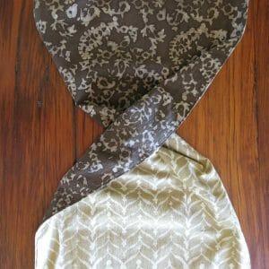 Vegan-friendly table runner, reversible plant dye batik print detail.