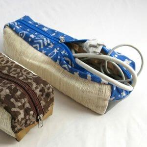 Vegan-friendly electronic cord case in faux leather, cotton and natural dye batik prints.