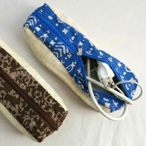 Vegan-friendly electronic cord case in faux leather, handspun, handwoven cotton and natural dye batik prints.
