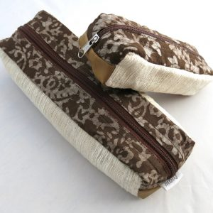 Vegan-friendly electronic cord case in faux leather, cotton, natural dye batik prints.