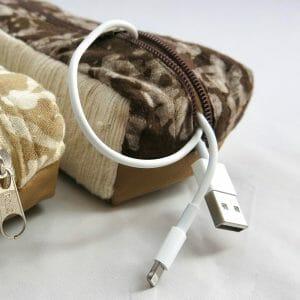 Vegan-friendly electronic cord case in cotton, faux leather, natural dye batik prints.