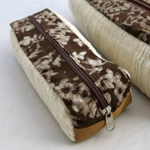 Vegan-friendly electronic cord case in faux leather, cotton and natural dye batik prints.