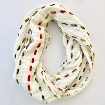 Soft cotton infinity scarf with strips of recycled saris.