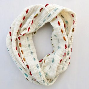 Soft cotton infinity scarf threaded through with strips of recycled saris.