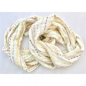 Soft cotton infinity scarf with coloured threads stitched through.