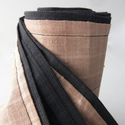 Handwoven cotton men's scarf with machine stitch detail.