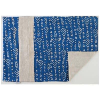 Vegan-friendly place mat with plant dyed batik prints and handspun, handwoven cotton khadi.