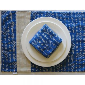 Vegan-friendly place mat and napkin with plant dyed batik prints and handspun, handwoven cotton khadi.