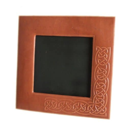 Custom hand embossed leather photo frame.