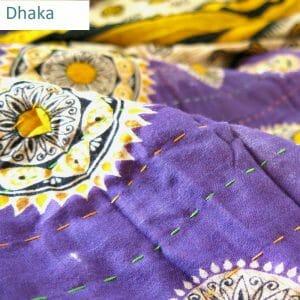 Wider Dhaka kantha stitch on recycled sari quilt.