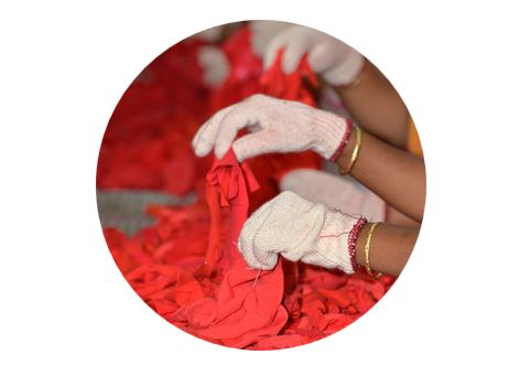 Sorting cotton garment waste, for recycling into cotton yarn.