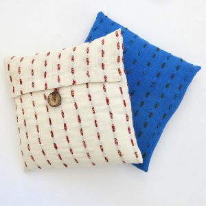 """Fair trade fabric 14"""" cushion cover. Hand stitching with recycled sari strips. Indigo dyed."""