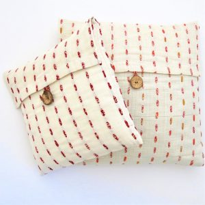 """Fair trade fabric 14"""" and 18"""" cushion cover. Hand stitching with recycled sari strips."""