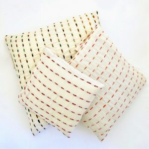 Fair trade fabric pillows. Hand stitching with recycled sari strips and naturally dyed.