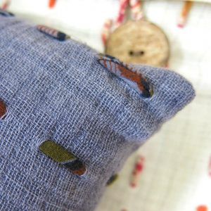 Fair trade fabric. Hand stitching with recycled sari strips and naturally dyed.