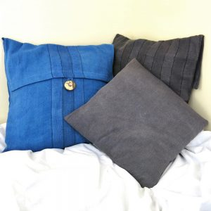 Sustainable fabric cushion covers handwoven with zero waste cotton, hand dyed with local indigo and other natural dyes. Vegan friendly.