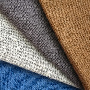 Sustainable fabric handwoven with recycled cotton yarn and hand dyed with natural dyes. Go Zero fabrics.