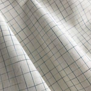 sustainable cotton ikat check white indigo