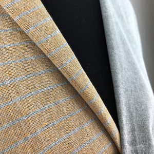 Handwoven, coordinated stripes and shot plain recycled fabrics in deep yellow and grey.